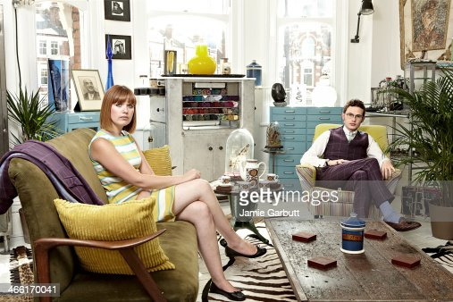 Couple sitting in retrostyled living room stock photo for Young couple living room ideas