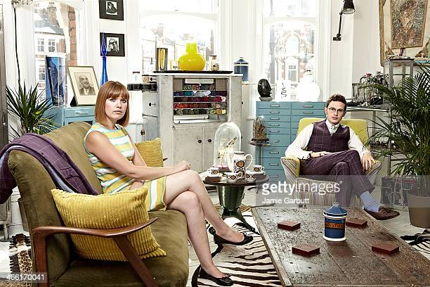 Couple sitting in retro-styled living room.