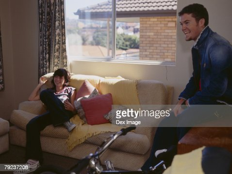 Couple sitting in the room : Stock Photo