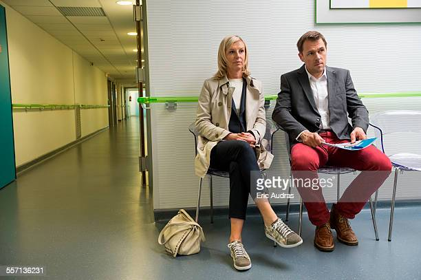 Couple sitting in the waiting area of a hospital