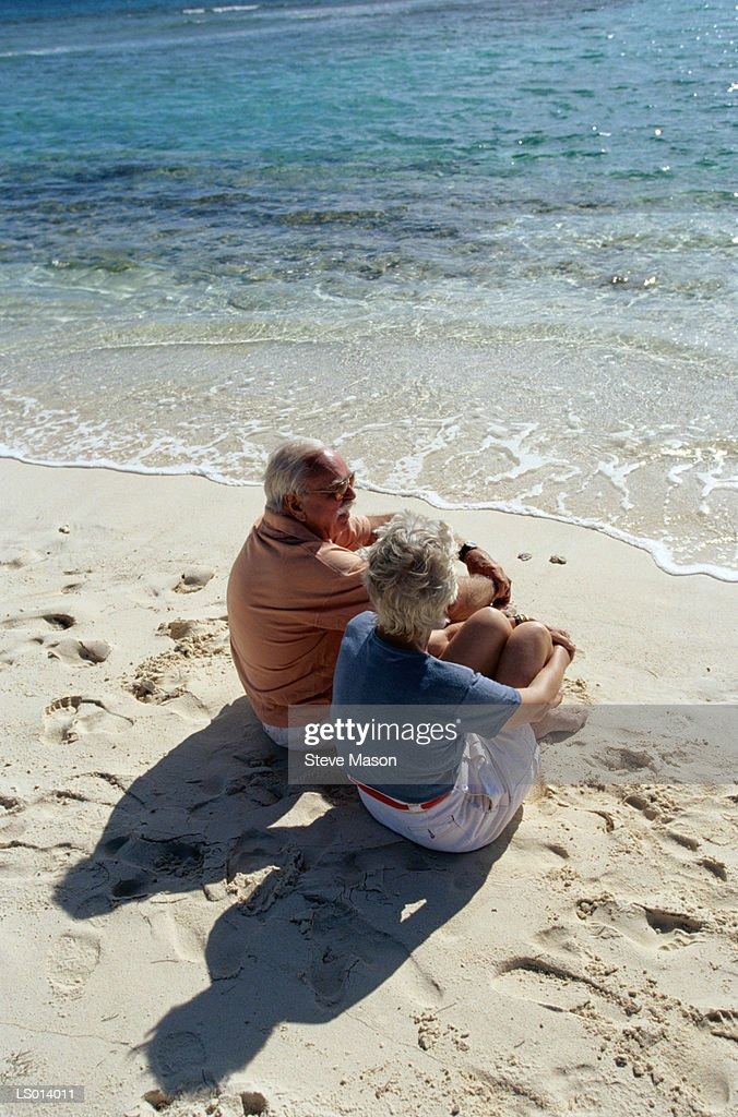 Couple Sitting on Beach : Stock Photo