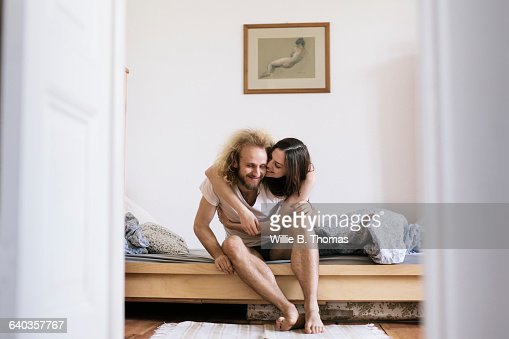 Couple sitting on Bed Hugging