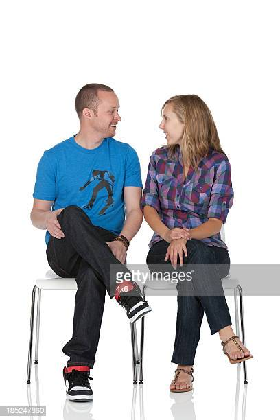 Couple sitting on chairs