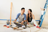 Couple sitting on floor during room remodeling