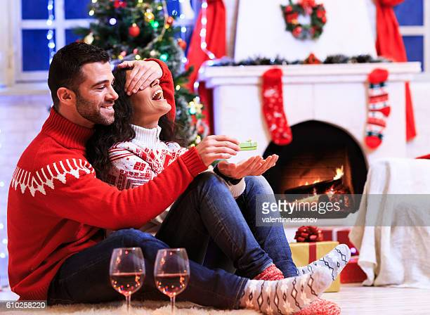 Couple sitting on ground at home - engagement