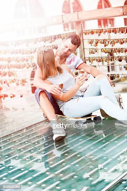 Couple sitting on longboard