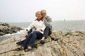 Couple sitting on rocks