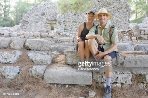 Couple sitting on Roman ruins of Phaselis. : Stock Photo