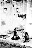 Couple sitting on Rue Vicomte de Souillac Auroville Pondicherry, Tamil Nadu, India, Asia, 1979