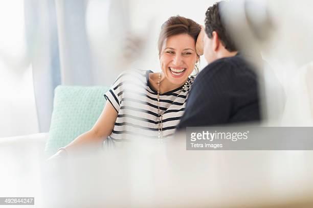 Couple sitting on sofa, Jersey City, New Jersey, USA