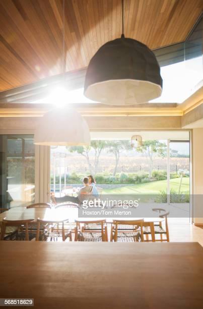 Couple sitting on sunny luxury patio