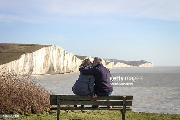 Couple sitting on the bench looking at the view