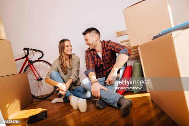 Couple sitting on the floor of new home