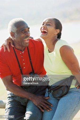 Couple sitting outdoor : Stock Photo