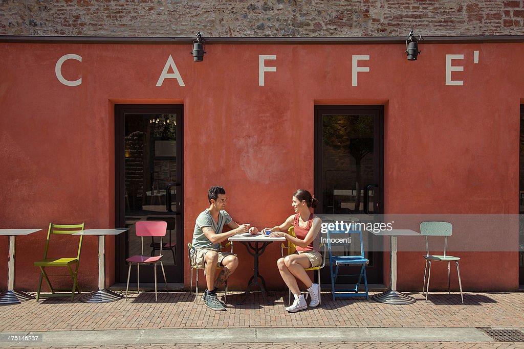 Couple sitting outside cafe, Florence, Tuscany, Italy
