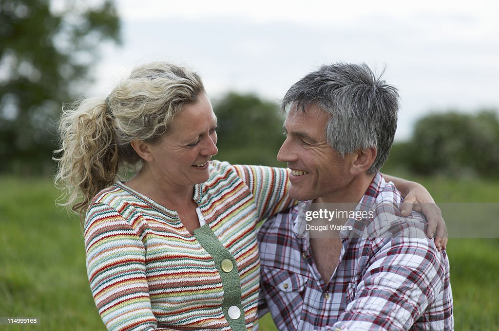 Couple sitting together in countryside. : Stock Photo
