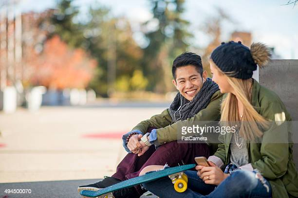 Couple Sitting Together Outside