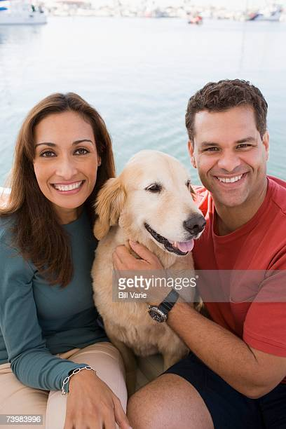 Couple sitting with their dog