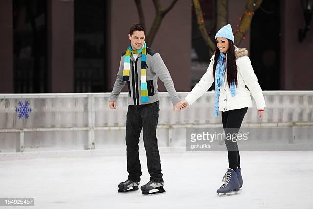 Couple Skating On Ice