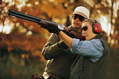 Couple skeet shooting