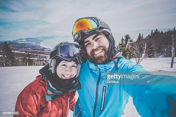 Couple Skier, Snowboarder Taking a Selfie at the Mountain