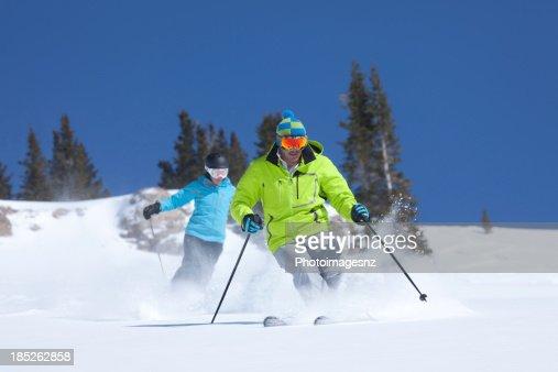 Couple skiing in fresh Powder snow, Colorado,USA