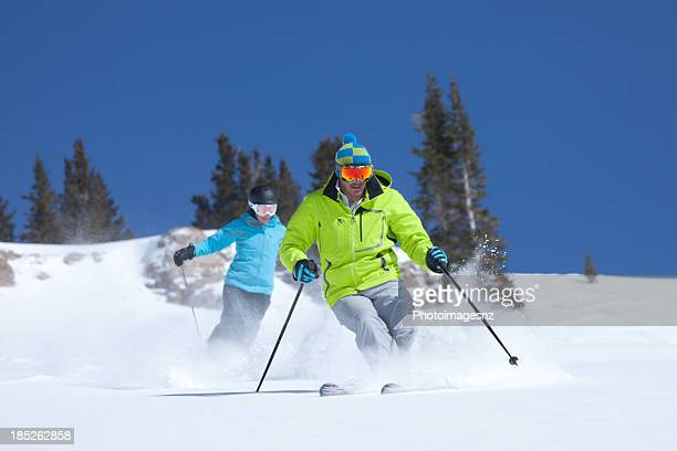 Couple skiing in fresh Powder snow, Colorado,USA