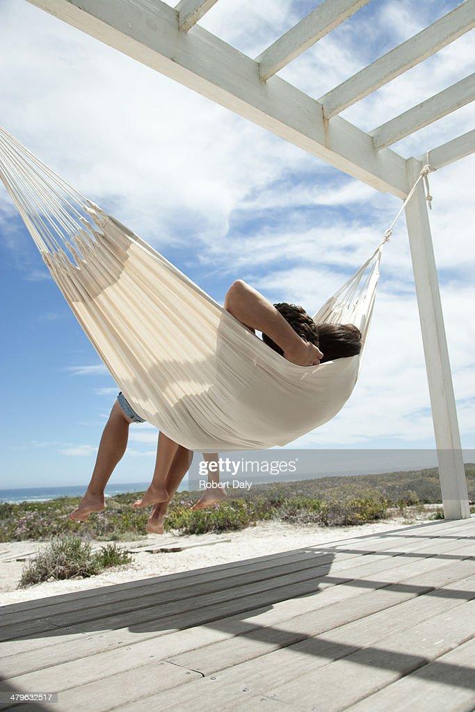 A couple sleeping in a hammock : Stock Photo