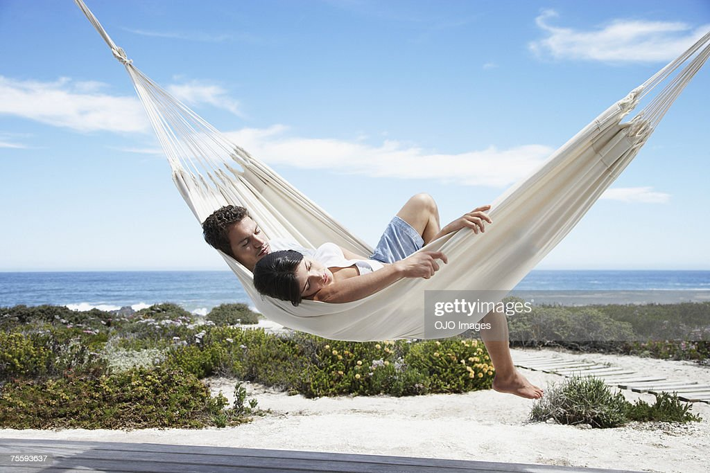 A couple sleeping in a hammock