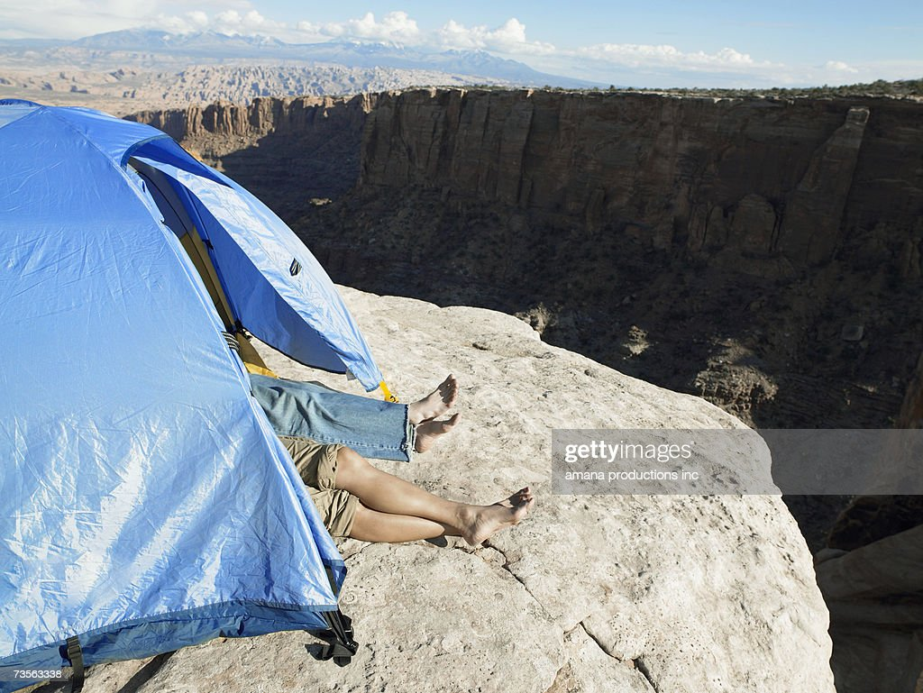 Couple sleeping in tent by cliff high angle view Moab Utah USA & Couple Sleeping In Tent By Cliff High Angle View Moab Utah Usa ...