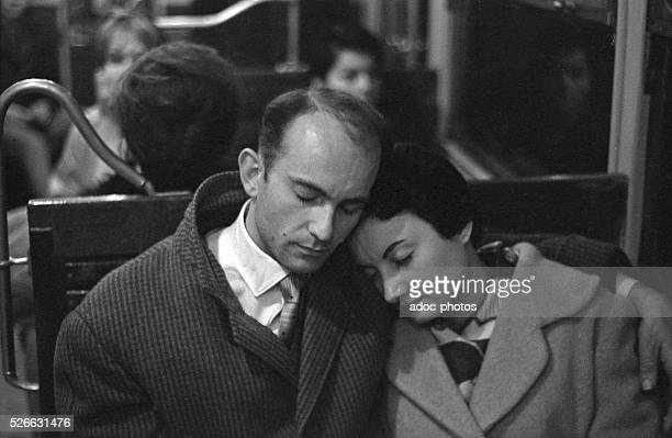 A couple sleeping in the Parisian subway In 1952