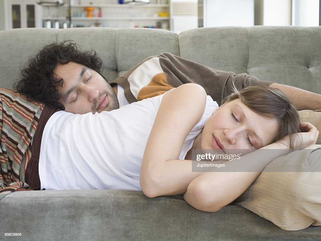 Couple sleeping on couch : Stock Photo