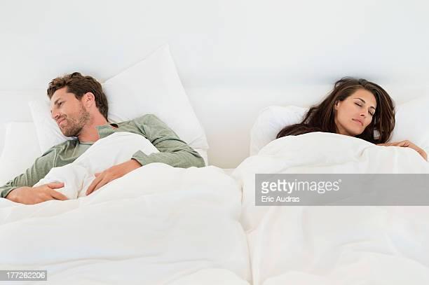 Couple sleeping on the bed