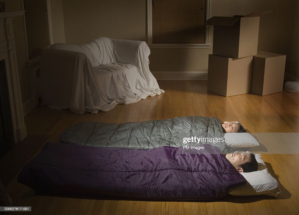 Couple Sleeping Side By Side In Sleeping Bags On Living Room Floor : Stock  Photo Part 93