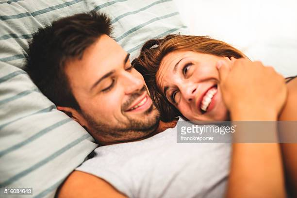 couple sleeping togetherness on the bed