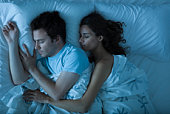 Couple sleeping, woman embracing man