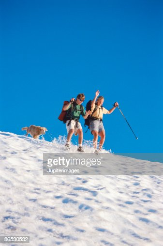 Couple sliding in snow : Stock Photo