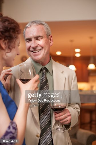 Couple Smiling and Drinking Wine at Cocktail Party : Stock Photo