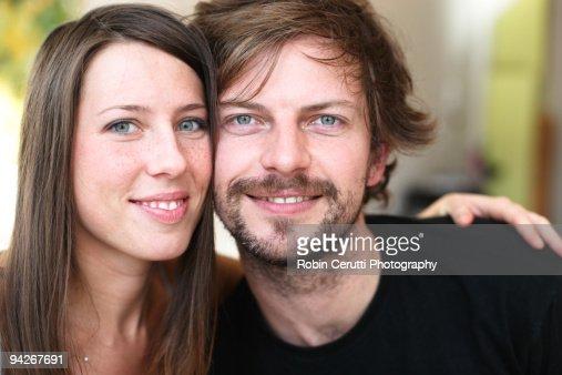 Couple smiling at breakfast : Bildbanksbilder