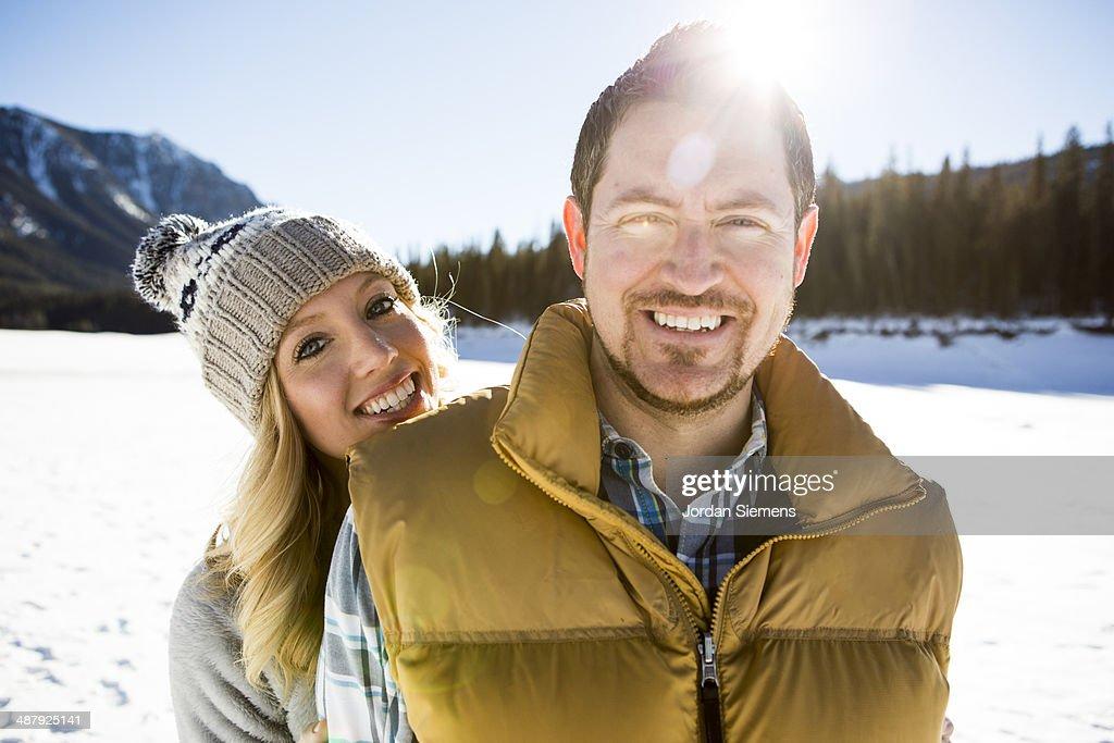 Couple smiling at camera.