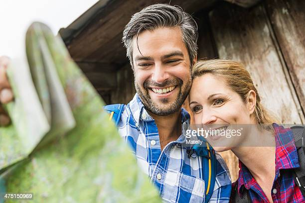 Couple smiling at map
