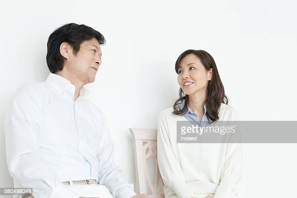 Couple Smiling face to face