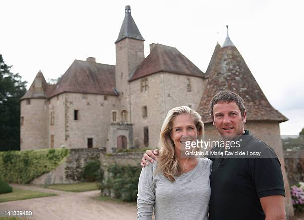 Couple smiling outside medieval castle