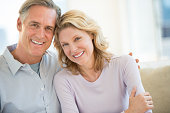 Portrait of mature couple smiling together at home