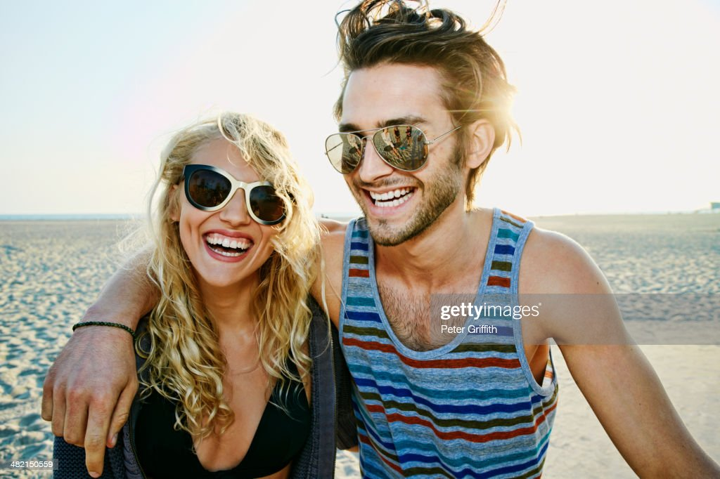 Couple smiling together on beach : Stock Photo