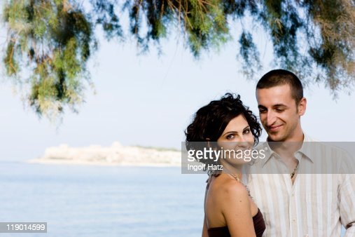 Couple smiling together on waterfront : Stock Photo