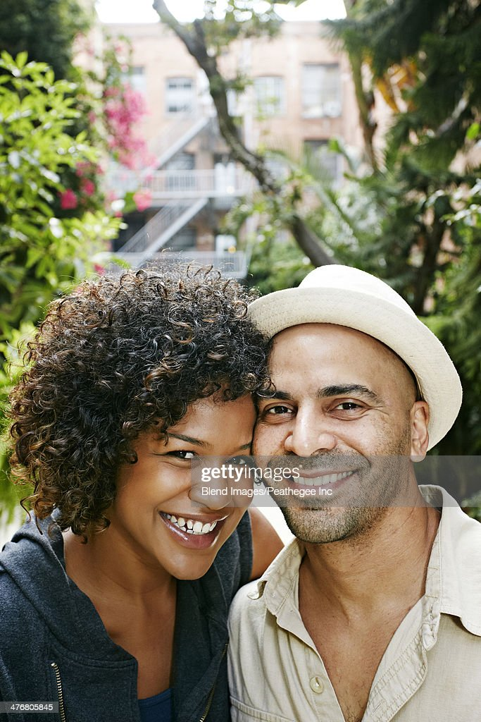 Couple smiling together outdoors : Stock Photo