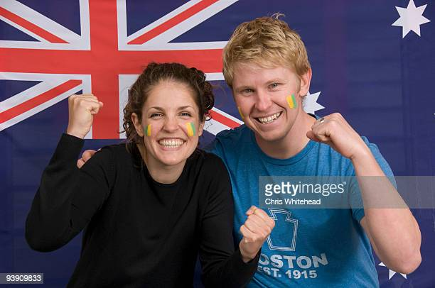 Couple smiling with Australian flag