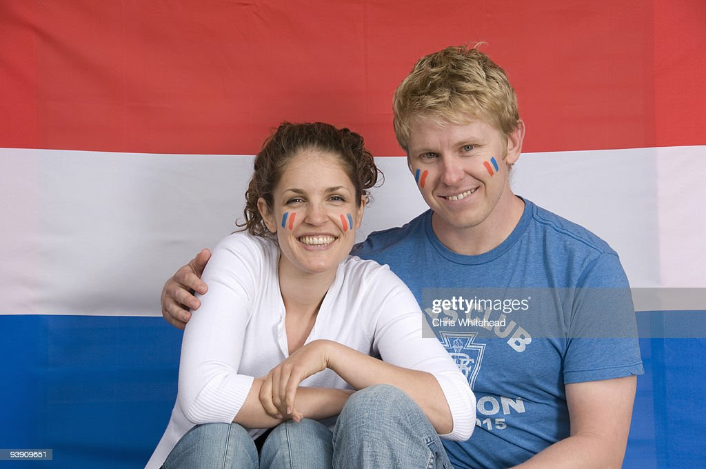 Couple smiling with Dutch flag : Stock Photo