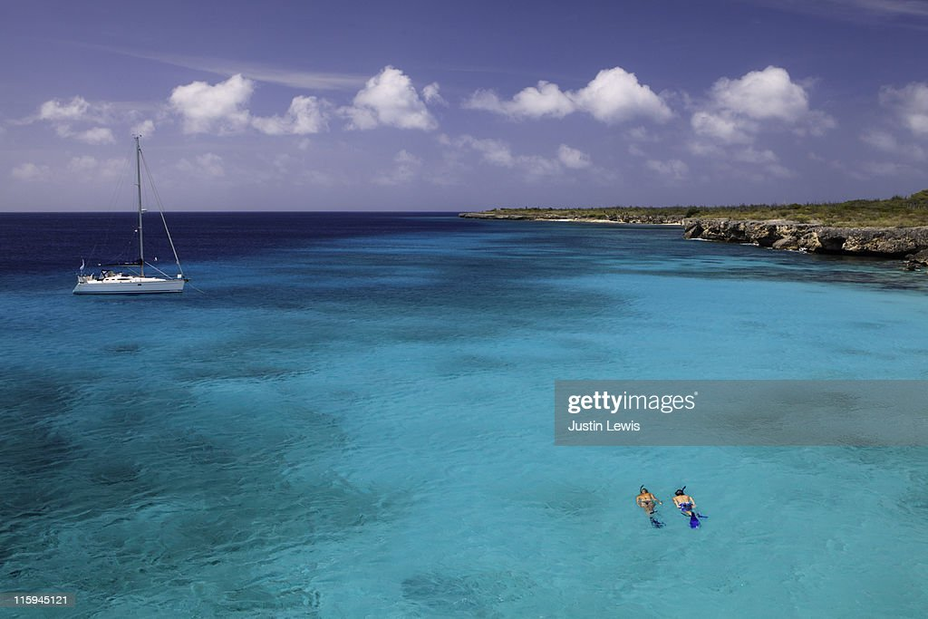 Couple snorkeling in blue water. : Stock Photo